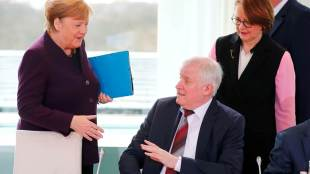 German Interior Minister Horst Seehofer refuses to shake the hand of German Chancellor Angela Merkel for hygienic reasons before a migration summit at the Chancellery in Berlin, Germany, March 2, 2020. REUTERS/Hannibal Hanschke TPX IMAGES OF THE DAY